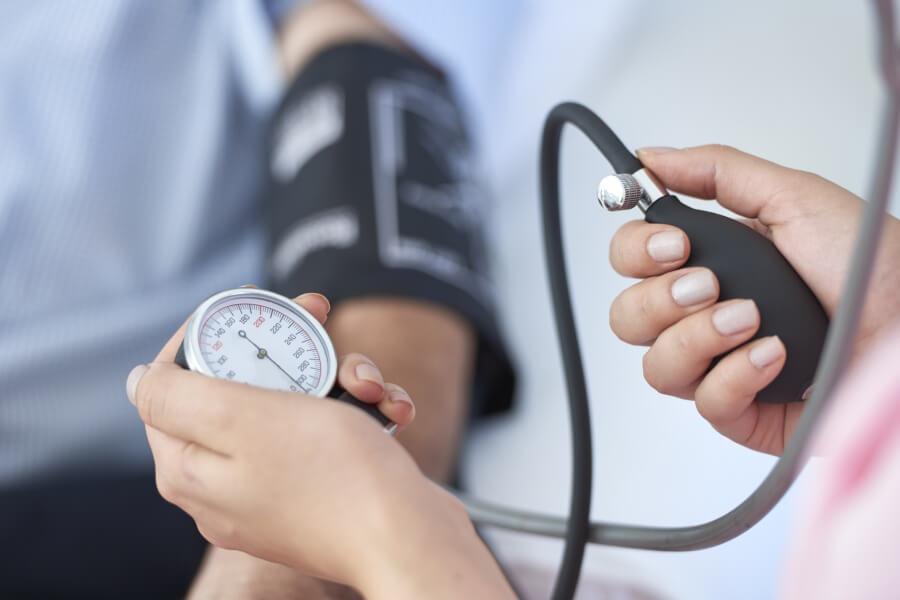 Nurse measuring blood pressure.
