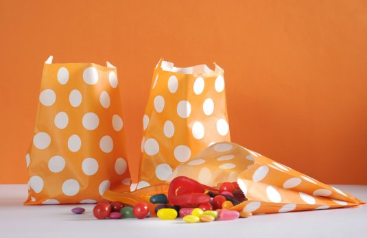 Check the treats children receive on Halloween and throw away spoiled, unwrapped or otherwise suspicious items.