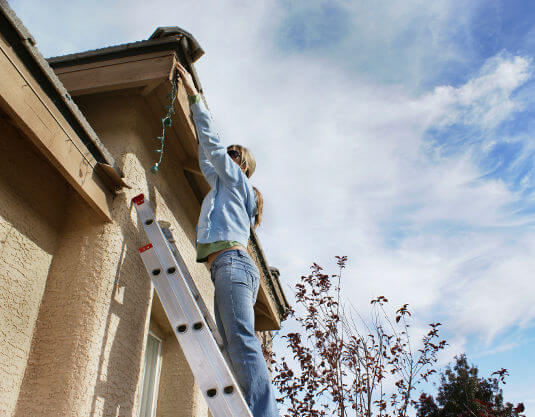 When using a ladder to install Christmas lights, place the bottom of it 0.3 metres away from the wall for every 1.2 metres of rise.