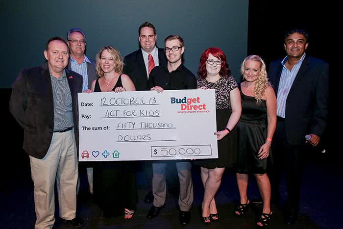 Budget Direct Staff present $50000 to Act for Kids